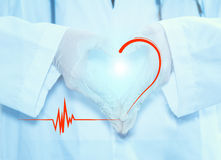 Doctor hand for heart. Royalty Free Stock Photos