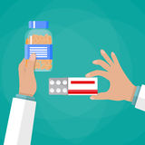 Doctor hand holding box of pills and capsules Stock Image