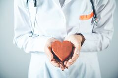Free Doctor Hand Holding Red Heart. Royalty Free Stock Images - 214985239