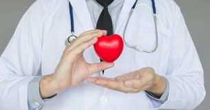 Doctor hand holding red heart ,Concept Healthcare and Medical at the office. Hospotal stock photos