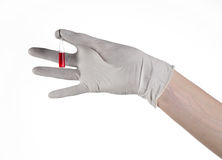 Doctor hand holding a vial, ampule red, vaccine ampule, Ebola vaccine, flu treatment, white background Stock Photography