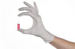 Doctor hand holding a vial, ampule red, vaccine ampule, Ebola vaccine, flu treatment, white background Royalty Free Stock Image