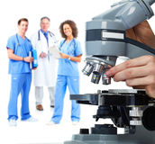 Doctor hand with microscope. Royalty Free Stock Photos