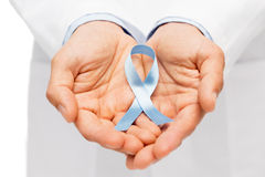 Doctor hand with prostate cancer awareness ribbon Royalty Free Stock Images