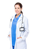 Doctor with hand put into the pocket Stock Photography