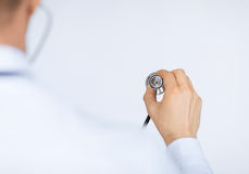 Doctor hand with stethoscope listening somebody stock photography