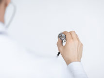 Doctor hand with stethoscope listening somebody Stock Photo