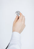 Doctor hand with stethoscope listening somebody Royalty Free Stock Photos