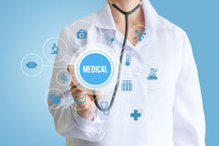 Doctor hand with stethoscope medical word . Royalty Free Stock Photo