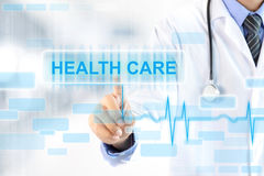 Doctor hand touching HEALTH CARE sign on virtual screen Royalty Free Stock Images