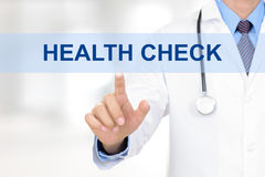 Doctor hand touching HEALTH CHECK sign on virtual screen. Doctor hand touching blue HEALTH CHECK sign on virtual screen Royalty Free Stock Photography