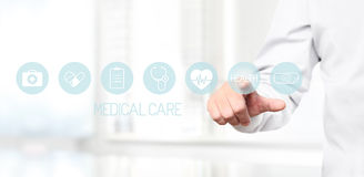 Doctor hand touching medical icons on virtual screen Royalty Free Stock Images
