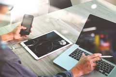 Doctor hand working with modern digital tablet and laptop comput Royalty Free Stock Photo