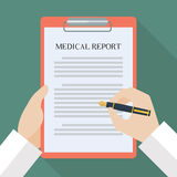 Doctor hand writing on medical report Stock Image