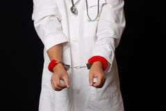 Doctor handcuff  to debate healthcare reform Royalty Free Stock Images