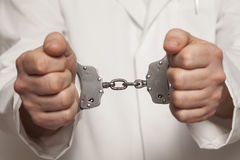 Doctor in handcuffs Stock Photography