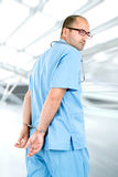 Doctor in handcuffs Royalty Free Stock Images