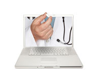 Doctor Handing Pill Through Laptop Screen Stock Images
