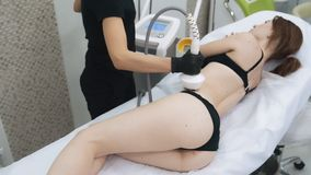 Doctor hands apply special gel on woman body, do lifting procedure, slow motion