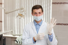 Doctor hands. Dentist hands wearing rubber gloves Stock Images
