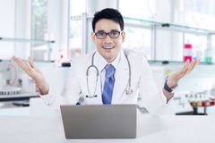 Doctor with hands gesture in the lab Royalty Free Stock Image