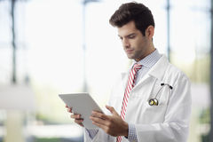 Doctor hands holding digital tablet. Male doctor hands holding digital tablet in hospital Stock Photography