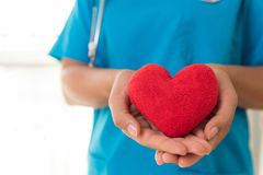 Doctor hands holding red heart. Healthcare And Medical concept. Doctor hands holding red heart. Healthcare And Medical concept royalty free stock photo