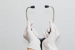 Doctor hands holding a stethoscope Royalty Free Stock Image