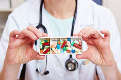 Doctor hands holding tablets Stock Images