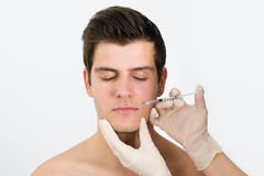 Doctor Hands Injecting Botox Injection In Man Face Royalty Free Stock Image