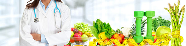 Doctor hands. Over fruits and vegetables background stock photo