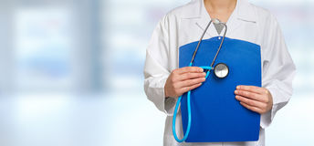 Doctor hands with stethoscope and clipboard Royalty Free Stock Image