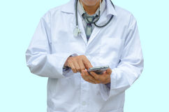 Doctor hands texting on a smart phone Stock Image