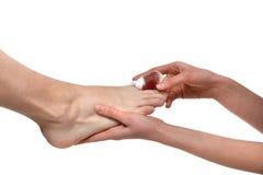 Doctor hands treat mens leg with икщлут blood bandaged pai Stock Image