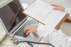 Doctor hands typing Stock Image