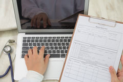 Doctor hands typing royalty free stock photo