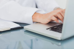 Doctor hands typing on a laptop Royalty Free Stock Photography