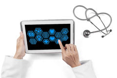 Doctor hands using medical icons on tablet Royalty Free Stock Photography