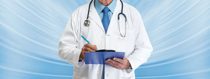 Doctor hands writing on clipboard. Medical doctor pharmacist hands writing prescription on blue background Stock Photography