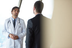 Doctor handshake with a patient Royalty Free Stock Photography