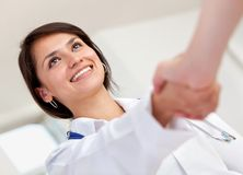 Doctor handshaking Stock Images