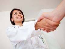 Doctor handshaking Stock Photo