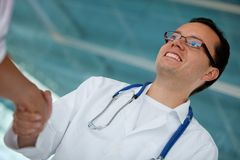 Doctor handshaking Royalty Free Stock Image