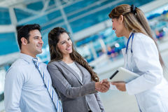 Doctor handshaking a couple Royalty Free Stock Image
