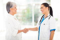 Doctor handshaking patient Stock Photography