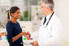 Doctor handshaking patient Stock Photos