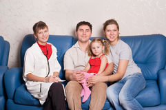 The doctor and happy family. Women doctor and happy family Royalty Free Stock Photo