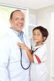 Doctor have fun with his patient Royalty Free Stock Image