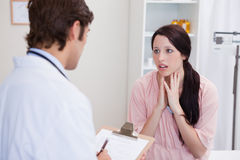 Doctor having bad news for his patient Royalty Free Stock Photo