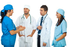 Doctor having conversation with her team. Doctor woman having conversation with her team  of doctors isolated on white background,check also  Medical Royalty Free Stock Image